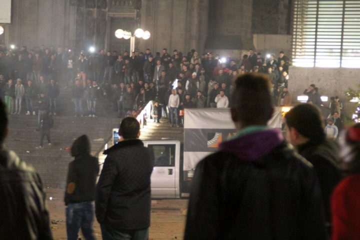 2016-01-06 10:38:50 Picture taken on December 31, 2015 shows people gathering in front of the main railway station in Cologne, western Germany. Police in Cologne told AFP they have received more than 100 complaints by women reporting assaults ranging from groping to at least one reported rape, allegedly committed in a large crowd of revellers during year-end festivities outside the city's main train station and its famed Gothic cathedral. / AFP / dpa / Markus Boehm / Germany OUT