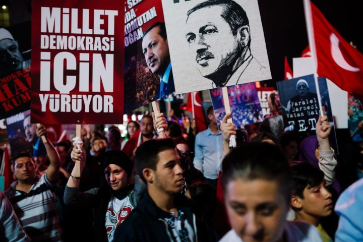 2016-07-20 15:06:03 People hold placards with a picture of Turkish President Recep Tayyip Erdogan during a rally at Kizilay Square in Ankara on July 20, 2016, following the failed military coup attempt of July 15. Erdogan on July 20 chaired a crunch security meeting for the first time since the failed coup, as global alarm grew over a widening purge that has seen around 50,000 people either detained or sacked. / AFP PHOTO / DIMITAR DILKOFF