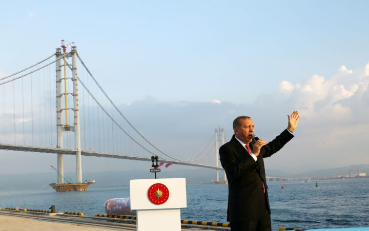 """2016-06-30 18:02:16 This handout picture taken and provided on June 30,2016 in kocaeli shows Turkish President Recep Tayyip Erdogan delivering a speech during the opening ceremony of Osmangazi Bridge. Turkish President Recep Tayyip Erdogan on June 30, 2016 inaugurated the fourth-longest suspension bridge in the world, the latest of his pet mega-projects. / AFP PHOTO / TURKISH PRESIDENTIAL PRESS OFFICE / KAYHAN OZER / RESTRICTED TO EDITORIAL USE - MANDATORY CREDIT """"AFP PHOTO / TURKISH PRESIDENTIAL PRESS OFFICE/ KAYHAN OZER"""" - NO MARKETING NO ADVERTISING CAMPAIGNS - DISTRIBUTED AS A SERVICE TO CLIENTS"""