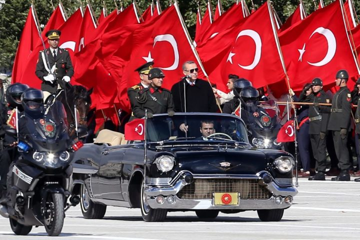 2015-10-29 10:32:28 Turkish President Recep Tayyip Erdogan (R) and Chief of the General Staff of the Turkish Armed Forces Hulusi Akar (L) are driven in a car past Turkish soldiers during a ceremony marking the 92nd anniversary of Republic Day on October 29, 2015 at the Ataturk Cultural Center in Ankara. AFP PHOTO / ADEM ALTAN