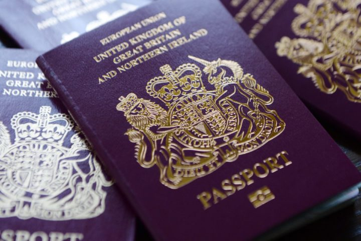 2014-06-13 06:48:12 epa04253139 British passports in London, Britain, 13 June 2014. The Home Office has said on 12 July that to help clear the huge backlog of passport applications it will scrap charges for urgent renewals. Some 30,000 people have been impacted by the delays. EPA/ANDY RAIN