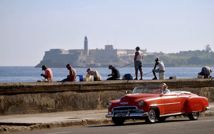 2015-09-18 19:43:34 TOPSHOTS Men fish at Havana's Malecon a day before Pope Francis' arrival in Cuba on September 18, 2015. AFP PHOTO / FILIPPO MONTEFORTE