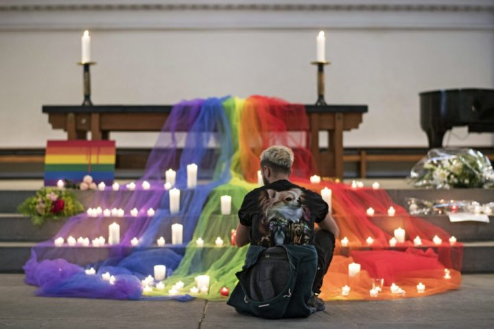 2016-06-13 18:18:06 epa05362268 A Swiss LGBT activists places a candle during a vigil for the victims of a mass shooting in Orlando, USA on 12 June, at a church in Zurich, Switzerland, 13 June 2016. A total of 50 people inculding the suspect were killed and 53 were injured in a shooting attack at an LGBT club in Orlando, Florida, in the early hours of 12 June. The shooter, Omar Mateen, 29, a US citizen of Afghan descent, was killed in an exchange of fire with the police after taking hostages at the club. EPA/ENNIO LEANZA
