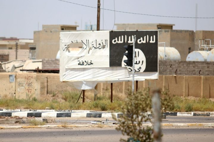 2016-06-26 00:00:00 A billboard of the Islamic State group is seen in Fallujah, 50 kilometres (30 miles) from the Iraqi capital Baghdad, after Iraqi forces retook the embattled city from the jihadist group on June 26, 2016. Iraqi Prime Minister Haider al-Abadi urged all Iraqis to celebrate the recapture of Fallujah by the security forces and vowed the national flag would be raised in Mosul soon. While the battle has been won, Iraq still faces a major humanitarian crisis in its aftermath, with tens of thousands of people who fled the fighting desperately in need of assistance in the searing summer heat. / AFP PHOTO / HAIDAR MOHAMMED ALI