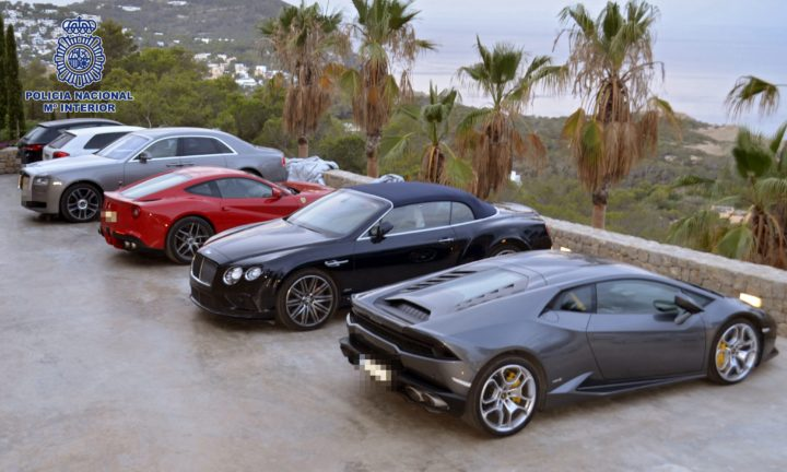 2016-07-23 00:00:00 epa05437865 A handout photograph provided by Spanish National Police shows luxury cars that were seized during a police operation against an arm smuggling and extortion gang, in Ibiza, the Balearic Islands, Spain, 22 July 2016. A total of 9 suspects were arrested, including a policeman and a millionaire who led a weapon traffiking gang, in an operation started in 2012 that has been carried out in different residences in Ibiza and companies in Germany, Switzerland, Belgium, France and United Kingdom, where the illegal organization had created a business network that was used as tax haven and to carry out the weapons sale. EPA/NATIONAL POLICE / HANDOUT HANDOUT EDITORIAL USE ONLY/NO SALES