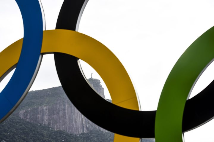 2016-08-05 01:02:53 epa05455231 The Christ the Redeemer statue is seen through Olympic ring located at the rowing venue at the Rodrigo de Freitas Lagoon in Rio de Janeiro, Brazil, 04 August 2016. EPA/LUKAS COCH AUSTRALIA AND NEW ZEALAND OUT