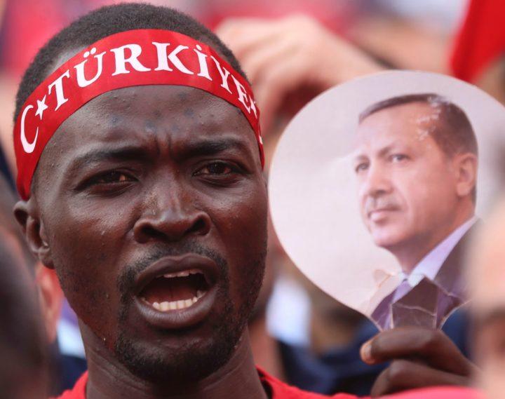 "2016-08-10 11:59:22 A man holds a picture of Turkish President Recep Tayyip Erdogan as people gather on August 10, 2016 at Kizilay Democracy Square in Ankara during a rally against failed military coup on July 15. A day after President Recep Tayyip Erdogan made a highly-symbolic visit to Russia, Foreign Minister Mevlut Cavusoglu said Turkish people's confidence in the EU had ""unfortunately fallen"" in the wake of the coup, saying the bloc ""failed a test"" on the night of the putsch. / AFP PHOTO / ADEM ALTAN"