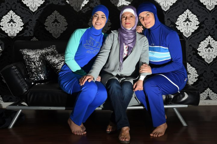 2016-08-19 11:55:32 Models clad in burqini swimsuits pose for photos with Australian-Lebanese designer Aheda Zanetti (C) in western Sydney on August 19, 2016. The light-weight, quick-drying two-piece swimsuit which covers the body and hair has been banned from French beaches by several mayors in recent weeks following deadly attacks linked to Islamic jihadists. / AFP PHOTO / SAEED KHAN