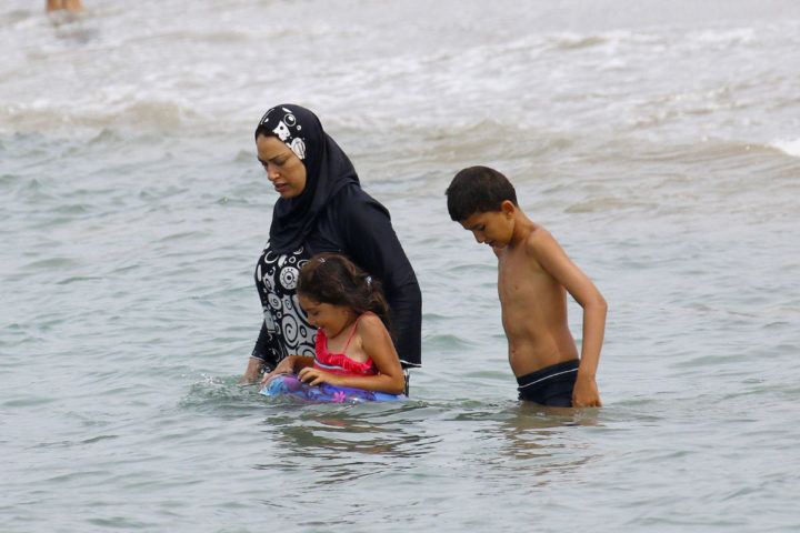 A Muslim woman wears a burkini, a swimsuit that leaves only the face, hands and feet exposed, on a beach in Marseille, France, August 17, 2016. REUTERS/Stringer ATTENTION EDITORS FRENCH LAW REQUIRES THAT THE FACES OF MINORS ARE MASKED IN PUBLICATIONS - RTX2LHQF