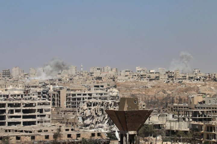 2016-07-26 14:46:07 Smoke billows from buildings during an operation by Syrian government forces to retake control of the rebel-held district of Leramun, on the northwest outskirts of Aleppo, on July 26, 2016. The Syrian Observatory for Human Rights said on July 26 loyalist troops had full control of the Leramun district after heavy clashes, and reported fighting for neighbouring Bani Zeid, which is also held by rebels. / AFP PHOTO / GEORGE OURFALIAN