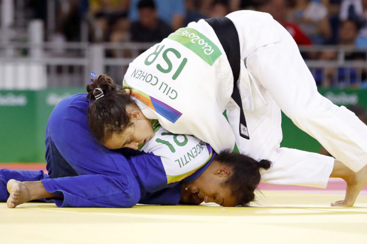 2016-06-09 13:11:11 Israel's Gili Cohen (white) competes with Mauritius' Christianne Legentil during their women's -52kg judo contest match of the Rio 2016 Olympic Games in Rio de Janeiro on August 7, 2016. / AFP PHOTO / Jack GUEZ