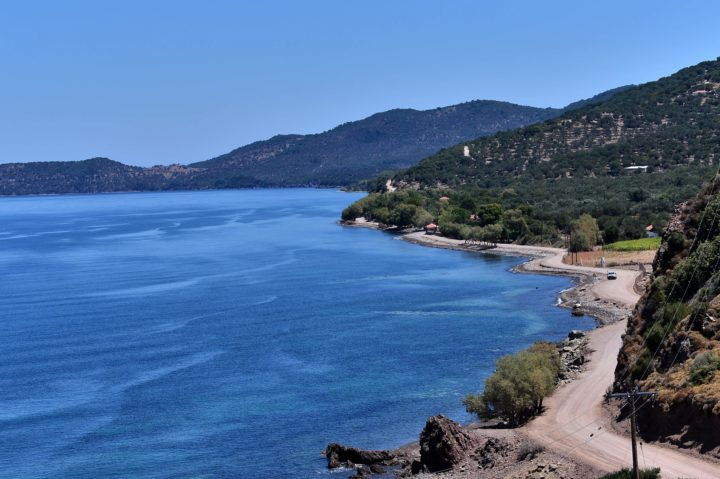 2016-07-21 13:43:08 This picture taken on July 21, 2016, shows empty beaches on the road between Molyvos and Skala Sykamias, where thousands of refugees and migrants landed by sea last year. When a sea of humanity landed on their island's rocky shores last year, the people of Lesbos turned out with blankets and hot food to help thousands of refugees emerging from the cold waters of the Aegean. But even these hospitality accolades have not helped to bring much-needed revenue to Lesbos at the height of the travel season, with many of the island's habitual foreign visitors seemingly put off by the migrant influx. / AFP PHOTO / LOUISA GOULIAMAKI