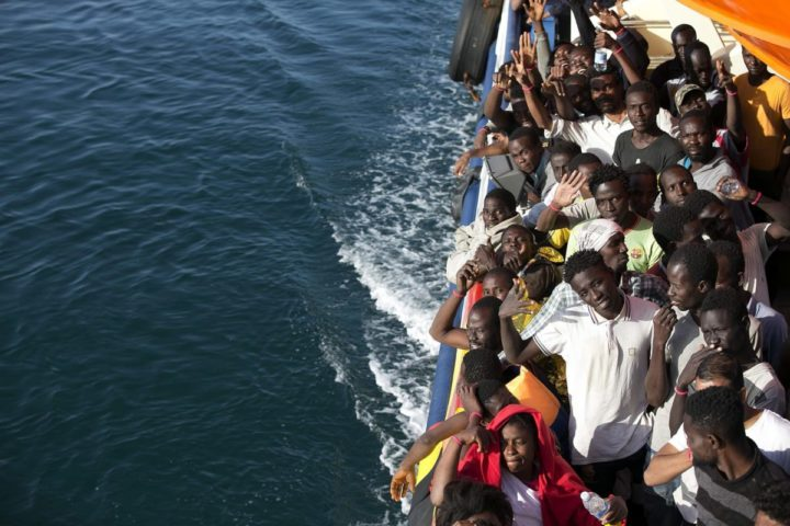 2016-08-20 12:22:20 epa05501710 A handout picture provided by the Italian Red Cross shows migrants looking at Sicily onboard the flagship rescue vessel Responder, a rescue boat run by the Malta-based NGO Migrant Offshore Aid Station (MOAS) and the Italian Red Cross (CRI), before arriving in Trapani, Italy, 20 August 2016. Two Syrian girls, one of them an eight-month-old baby, are among up to six people who died when a boat carrying would-be migrants to Europe capsized off Libya on 18 August, rescuers said. Five bodies were recovered and one passenger was missing, presumed drowned, following the capsize. EPA/YARA NARDI / ITALIAN RED CROSS/ HANDOUT HANDOUT EDITORIAL USE ONLY/NO SALES