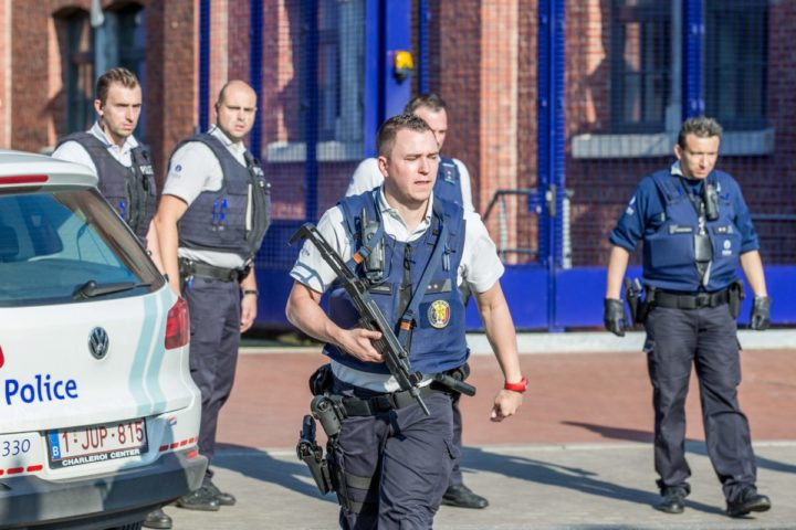epa05459043 Police Officers from Charleroi Police Zone oversee the place where two police officers were attacked with machetes in Charleroi , Belgium, 06 August 2016. One of the two police officer was slightly injured and the other is in serious conditions. EPA/STEPHANIE LECOCQ