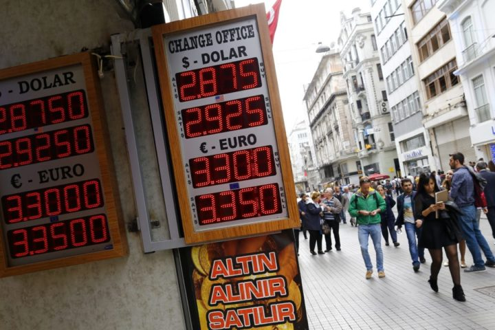 2016-05-06 14:49:28 epa05291892 People walk near exchange office on Istiklal Street in Istanbul, Turkey, 06 May 2016. The Turkish lira tumbled by 4.4 percent reaching 2.92 against the US dollar and 3.35 against the euro marking the worst drop since March 2015. Turkish Prime Minister Ahmet Davutoglu a day earlier announced that he will not run again for president of the ruling party, the Islamist Justice and Development Party, or AKP, during the extraordinary congress the party to be held on 22 May. EPA/SEDAT SUNA