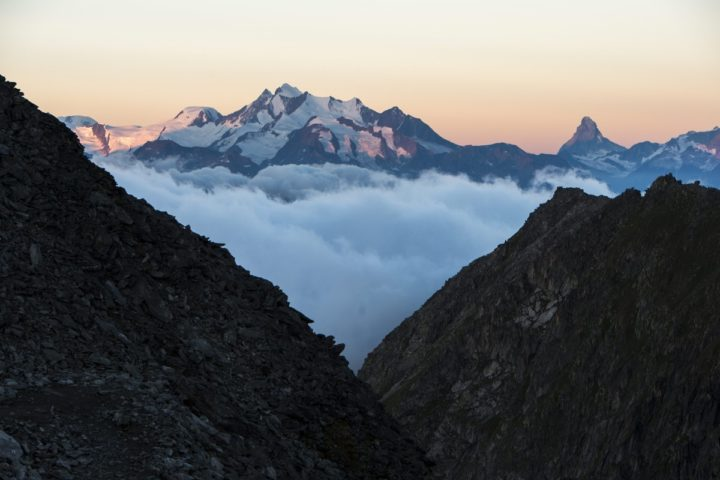 2015-07-28 06:12:12 epa04863396 On the left the Mischabel mountains, Alphubel mountain with the Dom mountain (highest mountain of Switzerland) and on the right the Matterhorn mountain after sunrise seen from the Eggishorn mountain, in Fiesch, Switzerland, early 28 July 2015. EPA/DOMINIC STEINMANN