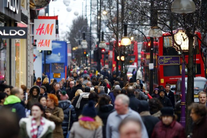 2013-12-21 12:37:40 epa03997849 Pedestrians walk down Oxford Street in central London, Britain, 21 December 2012. London's commercial district has been filled with Christmas shoppers on the last Saturday before Christmas. EPA/TAL COHEN