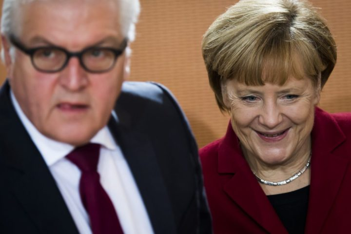 2014-10-22 00:05:55 German Chancellor Angela Merkel and Foreign minister Frank-Walter Steinmeier (L) arrive for the weekly cabinet meeting at the Chancellery in Berlin on October 22, 2014. AFP PHOTO / ODD ANDERSEN