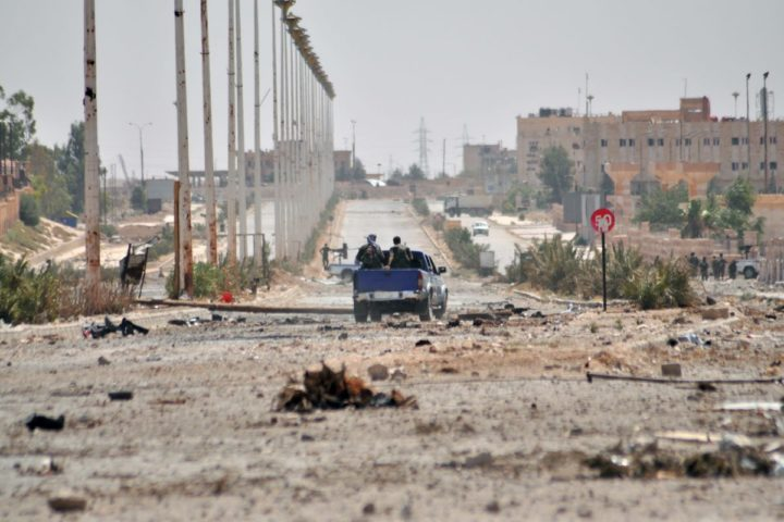 2015-07-26 11:14:37 Members of the Kurdish People's Protection Units (YPG) drive through a road in the Al-Nashwa neighbourhood in the northeastern Syrian province of Hasakeh on July 26, 2015. Syrian government troops and Kurdish forces advanced against Islamic State group fighters in the northeastern city of Hasakeh, the Syrian Observatory for Human Rights and state media said. AFP PHOTO / DELIL SOULEIMAN