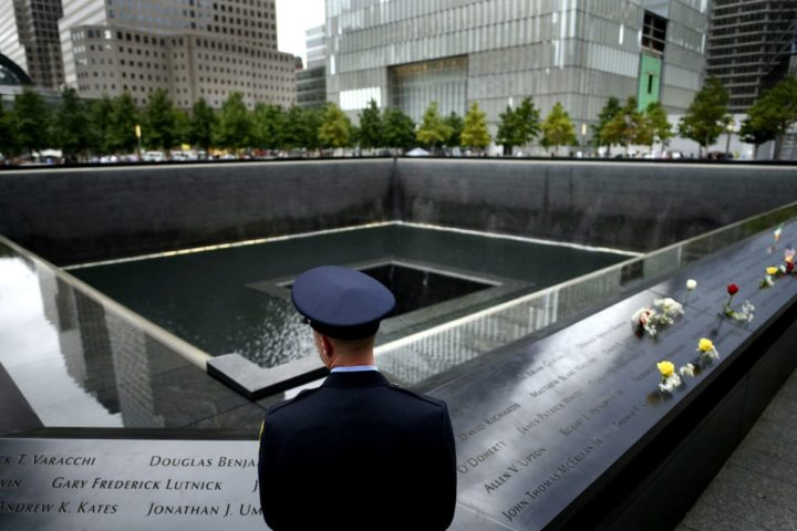 2015-09-11 10:15:49 epa04925569 A firefighter stands at the edge of the South Pool at the National September 11 Memorial during memorial observances on the 14th anniversary of the 9/11 terror attacks in New York, New York, USA, 11 September 2015. EPA/JUSTIN LANE