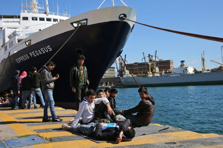 2016-03-03 10:24:19 epa05192542 Afghan refugees rest on a pier in the port of Piraeus where they stayed the past days, in Piraeus, Greece, 03 March 2016. Migration restrictions along the so-called Balkan route, the main path for migrants and refugees from Middle East to EU countries, have trapped thousands of them in Greece causing a humanitarian crisis. EPA/ORESTIS PANAGIOTOU