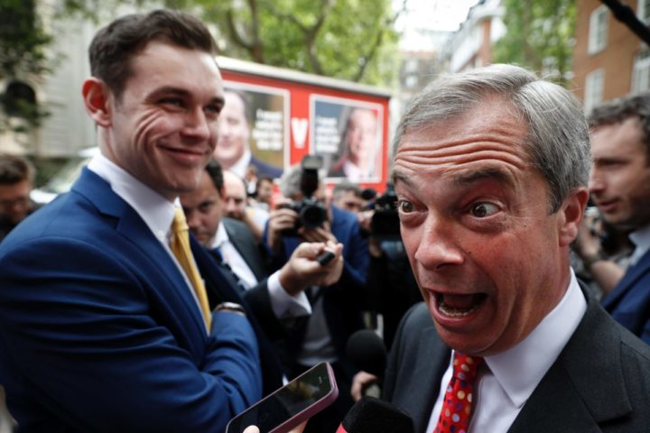 2016-06-07 11:15:07 UK Independence Party Leader (UKIP) Nigel Farage gestures while speaking to a journalist during the launch of a poster ahead of a television debate on the EU referendum in London on June 7, 2016. Prime Minister David Cameron will seek to regain the momentum in his campaign against a Brexit in a prime time appearance on on June 7, as young people rush to register to vote ahead of a midnight deadline. Cameron is under pressure to deliver a convincing television performance in a debate with UKIP leader Nigel Farage after opinion polls gave a slender lead to the campaign for Britain to leave the European Union in the June 23 referendum. / AFP PHOTO / ADRIAN DENNIS
