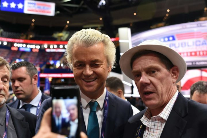 2016-07-19 13:47:51 Dutch politician Gert Wilders poses for a photograph with an unidentified man on the convention floor before the start of the second day of the Republican National Convention on July 19, 2016 at Quicken Loans Arena in Cleveland, Ohio. About 50,000 people are expected in Cleveland this week for the Republican National Convention, at which Donald Trump is expected to be formally nominated to run for the US presidency in November. / AFP PHOTO / Robyn BECK