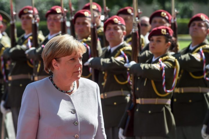 2016-08-25 13:59:31 epa05509676 German Chancellor Angela Merkel inspects the honour guard before talks with Czech Prime Minister Bohuslav Sobotka (not pictured) in Prague, Czech Republic, 25 August 2016. German Chancellor Angela Merkel is on a one-day working visit to the Czech Republic. EPA/FILIP SINGER