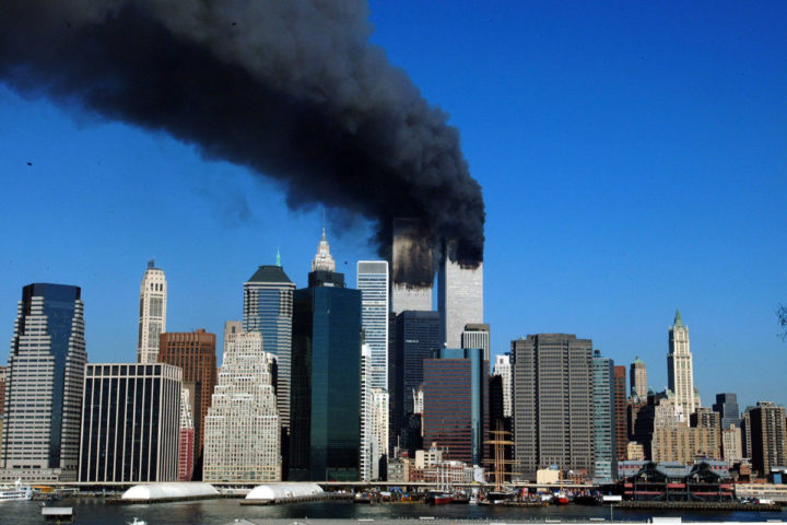 2001-09-11 00:00:00 (FILES) This file photo taken on September 11, 2001 shows the Twin Towers of the World Trade Center in New York billowing smoke after hijacked airliners crashed into them. The towers collapsed on that day claiming 2,753 lives. September 11, 2016 marks the fifteenth anniversary of the event. / AFP PHOTO / HENNY RAY ABRAMS