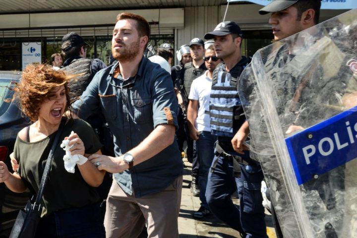 2016-09-09 10:19:06 Turkish police detain a woman during a protest in Diyarbakir on September 9, 2016. More than 11,000 teachers in Turkey have been suspended for alleged links to the outlawed Kurdistan Workers' Party (PKK), a week before children go back to school. Tens of thousands of school workers and private teachers were purged separately after a failed coup in July. / AFP PHOTO / ILYAS AKENGIN