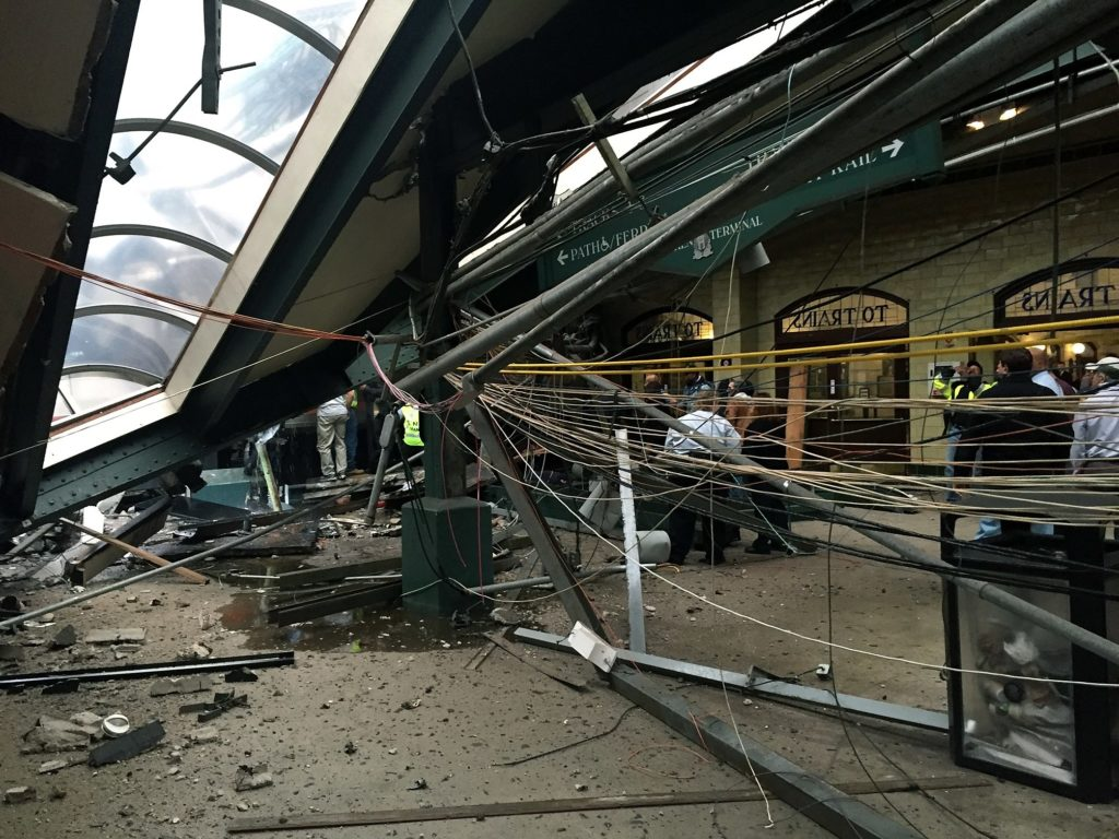 HOBOKEN, NJ - SEPTEMBER 29: The roof collapse after a NJ Transit train crashed in to the platform at the Hoboken Terminal September 29, 2016 in Hoboken, New Jersey. Pancho Bernasconi/Getty Images/AFP == FOR NEWSPAPERS, INTERNET, TELCOS & TELEVISION USE ONLY ==
