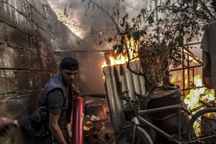 epa05535371 A firefighter tries to extinguish a fire following an airstrike by forces loyal to the Syrian government in the rebel-held area of Douma, outskirts of Damascus, Syria, 11 September 2016. The strikes come a day ahead of a ceasefire agreed on between Russia and USA, and agreed on by Syria's government, which will take effect on 12 September. EPA/MOHAMMED BADRA