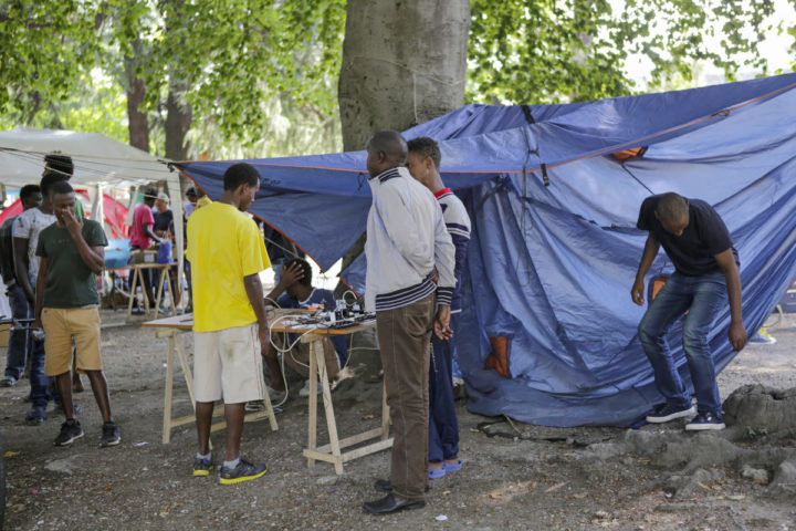 August 31, 2016 - Como, Lombardy, Italy - Refugees are charting their mobile phones in a tent provided by local volunteers Around a hundred refugees sleep rough outside Como San Giovanni railway station. From here, they try to cross the border into Switzerland by taking the train to Chiasso, which is just a 5 minutes ride away, but are regularly sent back by Swiss police. (Credit Image: © Michael Debets/Pacific Press via ZUMA Wire)
