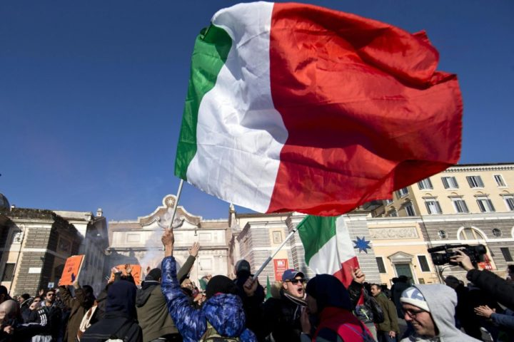2013-12-18 12:16:21 epa03995042 Demonstrators from the so-called 'Pitchfork Movement' wave the Italian flag during a demonstration in central Rome, Italy, 18 December 2013. The Pitchfork Movement is a loose-knit network originally composed of truckers and farmers opposed to austerity-driven tax hikes that has since grown into an umbrella group for the country's disgruntled, anti-government masses. Protesters blame government mismanagement for Italy's continuing economic crisis. EPA/GUIDO MONTANI