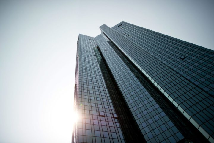 2015-04-23 00:00:00 epa04717508 The headquarters of the 'Deutsche Bank' in Frankfurt, Germany, photographed on 23 April 2015. Deutsche Bank has agreed to pay a fine of 2.5 billion dollars to US and British authorities in the Libor rate-fixing scandal and sack seven of its workers, the Department of Financial Services (DFS) in New York announced on 23 April. EPA/CHRISTOPHSCHMIDT