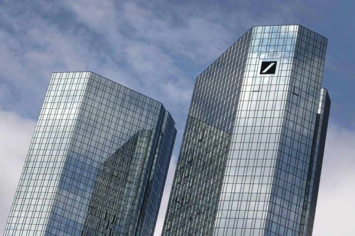 "2015-06-09 11:07:02 FILES - The headquarters of Germany's biggest lender Deutsche Bank are pictured on June 9, 2015 in Frankfurt am Main, western Germany. Scandal-plagued Deutsche Bank announced on October 18, 2015 a sweeping business and management shake-up that would ""fundamentally change"" its leadership structure. AFP PHOTO / DANIEL ROLAND"