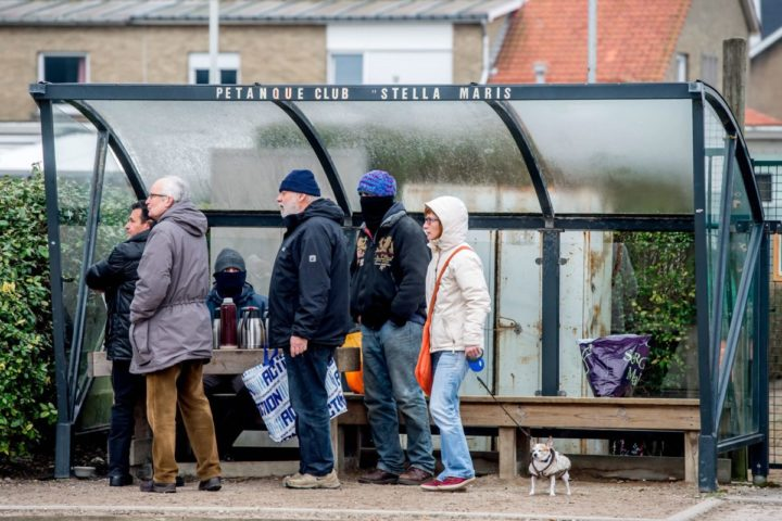 2016-02-13 11:06:10 epa05158473 Residents of the city of Zeebrugge bring food for migrants near the Stella Maris church in Zeebrugge, Belgium, 13 February 2016. Local residents were advised not to donate essential commodities to the camp in order not to encourage further influx of refugees to the neighbourhood. Meanwhile, garbage collectors were called in to clear the already piled up donated items at the migrants camp site, including personal belongings and tents. EPA/STEPHANIE LECOCQ
