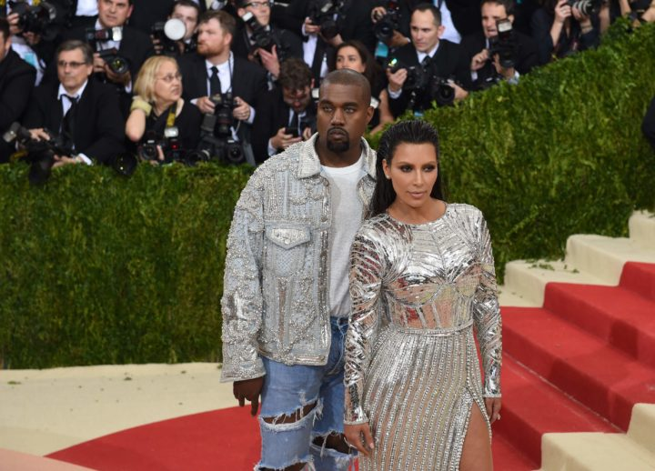 2016-05-02 20:56:07 Kim Kardashian Kanye West arrive for the Costume Institute Benefit at the Metropolitan Museum of Art on May 2, 2016 in New York. / AFP PHOTO / TIMOTHY A. CLARY