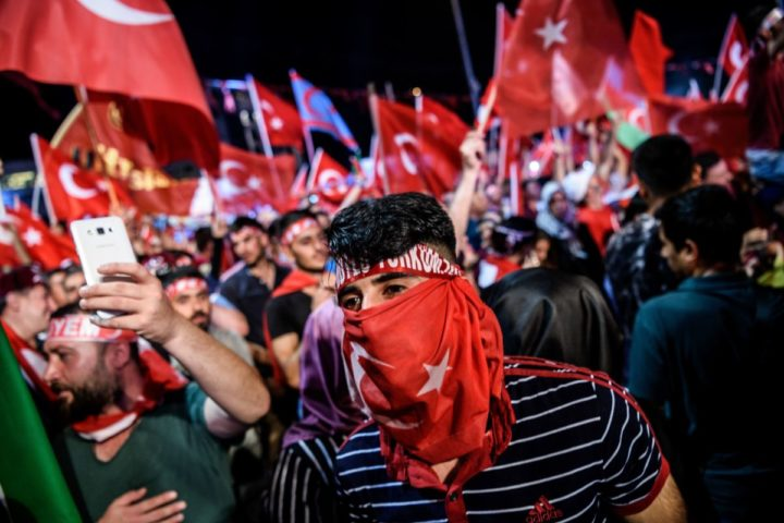 2016-07-23 20:36:56 Pro-Erdogan supporters wave Turkish national flags during a rally against the military coup on Taksim square in Istanbul on July 23, 2016. Turkey pushed on with a sweeping crackdown against suspected plotters of its failed coup, defiantly telling EU critics it had no choice but to root out hidden enemies. Using new emergency powers, President Recep Tayyip Erdogan's cabinet decreed that police could now hold suspects for one month without charge, and also announced it would shut down over 1,000 private schools it deems subversive. / AFP PHOTO / OZAN KOSE