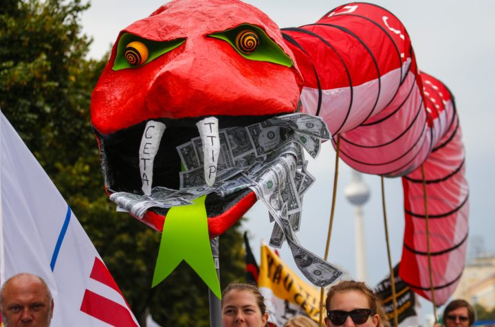 2016-09-17 11:18:37 Demonstrators protest against the massive transatlantic trade deals CETA and TTIP on September 17, 2016 in Berlin. Organisers of several demonstrations across Germany expect hundreds of thousands of people to take the streets in protest against the planned deals Transatlantic Trade and Investment Partnership (TTIP) between the European Union with the United States and it's smaller version CETA between the European Union and Canada. / AFP PHOTO / Odd ANDERSEN