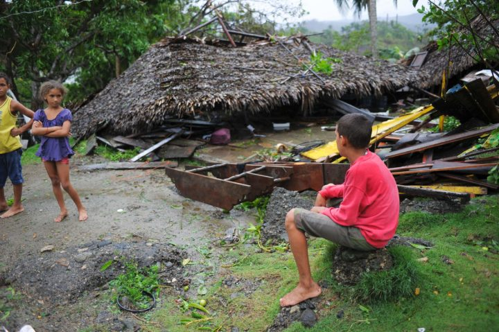2016-10-05 22:08:18 Children are seen before damaged property in the Carbonera community of Guantanamo, Cuba following Hurricane Matthew, October 5, 2016. The storm slammed into Haiti and Cuba as a Category Four hurricane on October 4, 2016 but has since been downgraded to three, on a scale of five, by the US National Hurricane Center (NHC). Its winds were howling at 115 miles per hour (185 kilometers per hour). / AFP PHOTO / YAMIL LAGE