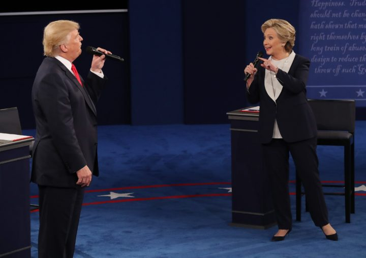 2016-10-09 09:13:21 epa05579084 Democrat Hillary Clinton (R) and Republican Donald Trump (L) during the second Presidential Debate at Washington University in St. Louis, Missouri, USA, 09 October 2016. The third and final debate will be held 19 October in Nevada. EPA/JIM LO SCALZO