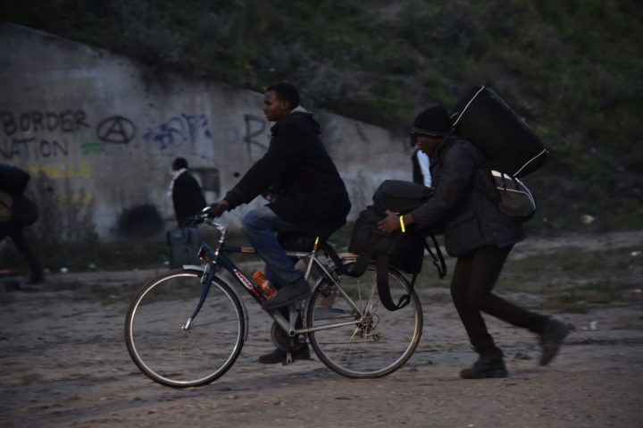 "2016-10-24 06:18:48 Migrants leave with their luggage as they head towards official meeting points set by French authorities as part of the full evacuation of the Calais ""Jungle"" camp, in Calais, northern France, on October 24, 2016. French authorities are set to begin on October 24, 2016 moving thousands of people out of the notorious Calais Jungle before demolishing the camp that has served as a launchpad for attempts to sneak into Britain. A major three-day operation is planned to clear the sprawling shanty town near Calais port -- a symbol of Europe's failure to resolve its migrant crisis -- of its estimated 6,000-8,000 occupants. The current Jungle camp dates from April 2015 and housed more than 10,000 migrants at its peak, although that number has dwindled to around 5,000 in its final days. / AFP PHOTO / PHILIPPE HUGUEN"