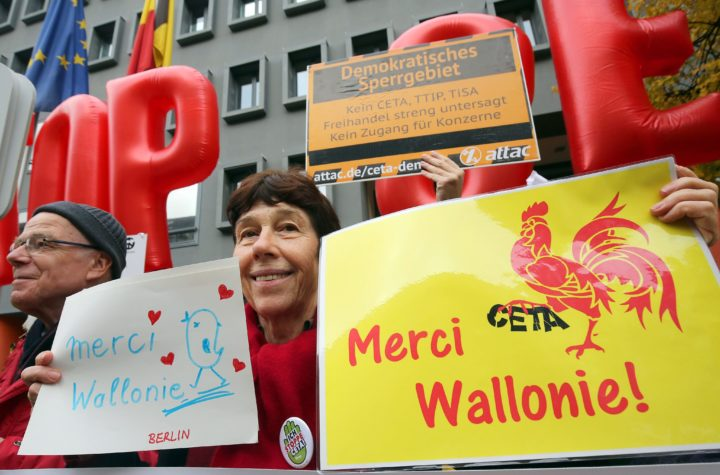 2016-10-26 00:00:00 epa05603827 Demonstrators of the association against TTIP, TiSA and CETA partake in a manifestation in front of the Belgian embassy under the motto: 'Merci Wallonie - Stop CETA!' in Berlin, Germany, 26 October 2016. EPA/WOLFGANG KUMM