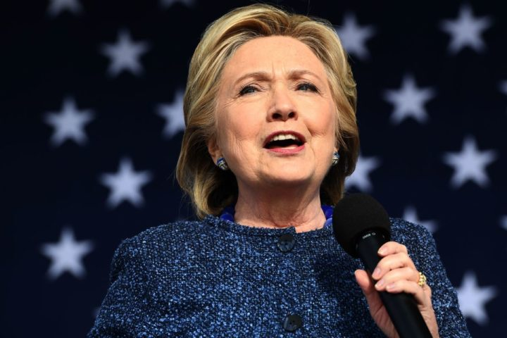 """2016-10-28 15:54:39 US Democratic presidential nominee Hillary Clinton speaks during a Democratic party """"Women Win"""" early vote rally in Cedar Rapids, Iowa, on October 28, 2016. The FBI dealt Hillary Clinton's seemingly unstoppable White House campaign a stunning blow Friday by reopening a probe into her use of a private email server while secretary of state. / AFP PHOTO / Jewel SAMAD"""