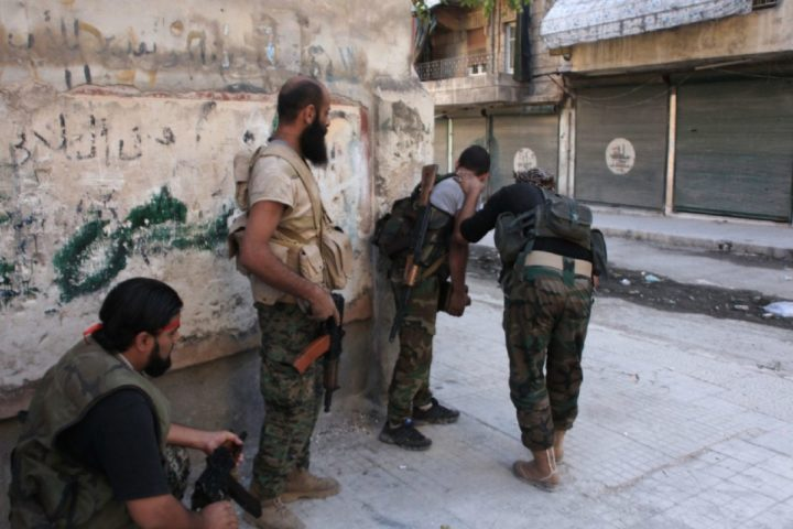 2016-09-30 10:08:46 Syrian pro-government forces take part in an operation to take control of Aleppo's Suleiman al-Halabi neighbourhood, which is divided by the frontline that separates the rebel-held east and regime-held west of the northern city, on September 30, 2016. Syrian regime forces advanced in the battleground city of Aleppo, backed by a Russian air campaign that a monitor said has killed over 3,800 civilians in the past year. / AFP PHOTO / GEORGES OURFALIAN