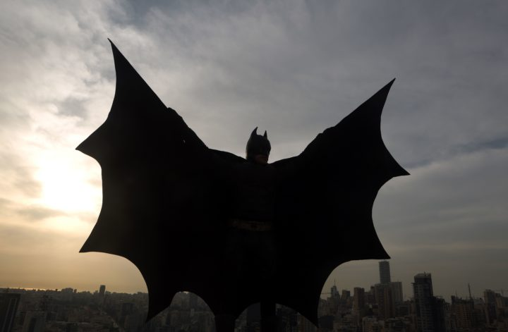 2016-03-23 19:02:35 TOPSHOT - A Lebanese model dressed as Batman plays on the rooftop of a building during a photoshoot in the capital Beirut on March 23, 2016. / AFP PHOTO / PATRICK BAZ