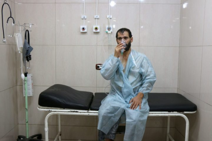 "2016-09-06 13:59:51 TOPSHOT - A Syrian man suffering from breathing difficulties is treated at a make-shift hospital in Aleppo after regime helicopters dropped barrel bombs on the rebel-held Sukkari neighbourhood of the northern Syrian city on September 6, 2016. The Britain-based Syrian Observatory for Human Rights said the bombs hit the Sukkari neighbourhood and that more than 70 people ""most of them civilians"" were treated for choking symptoms. / AFP PHOTO / THAER MOHAMMED"
