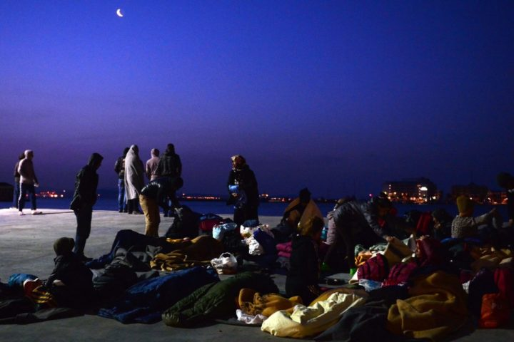 "2016-04-04 06:29:35 Migrants who camp out at the port of Chios wake up on April 4, 2016. Greece sent a first wave of migrants back to Turkey on April 4 under an EU deal that has faced heavy criticism from rights groups. Under the agreement, designed to halt the main influx which comes from Turkey, all ""irregular migrants"" arriving since March 20 face being sent back, although the deal calls for each case to be examined individually. For every Syrian refugee returned, another Syrian refugee will be resettled from Turkey to the EU, with numbers capped at 72,000. / AFP PHOTO / LOUISA GOULIAMAKI"