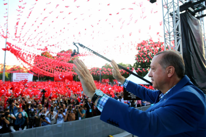 "2016-08-28 16:59:50 A handout picture taken and released on August 28, 2016 by Turkey's Presidential Press Service shows Turkish President Recep Tayyip Erdogan waving during a rally in Gaziantep. Turkish President Recep Tayyip Erdogan vowed on August 28, 2016 to devote equal energy to combatting Islamic State jihadists and Syrian Kurdish fighters, on the fifth day of a major offensive that has left dozens dead. ""For the issue of the PYD (Democratic Union Party) terror group in Syria, we have just the same determination,"" he added, referring to the main pro-Kurdish party in northern Syria and its People's Protection Units (YPG) militia. Turkish forces ramped up their offensive, with Turkish warplanes and artillery pounding areas held by pro-Kurdish forces close to a town liberated from IS this week. / AFP PHOTO / TURKEY'S PRESIDENTIAL PRESS SERVICE / KAYHAN OZER / RESTRICTED TO EDITORIAL USE - MANDATORY CREDIT ""AFP PHOTO / TURKEY'S PRESIDENTIAL PRESS SERVICE /KAYHAN OZER"" - NO MARKETING NO ADVERTISING CAMPAIGNS - DISTRIBUTED AS A SERVICE TO CLIENTS"